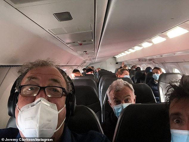 Masked men: Jeremy is pictured with his The Grand Tour co-star Richard Hammond [R] and producer Andy Wilman [C] en route to a filming destination in October