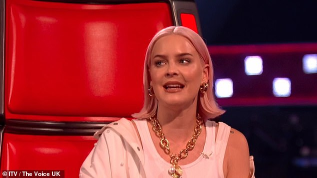 Ready for action: Anne-Marie wore a contrasting outfit which comprised of a white vest and matching denim jacket as she begun her judging duties in the iconic red swivel chair