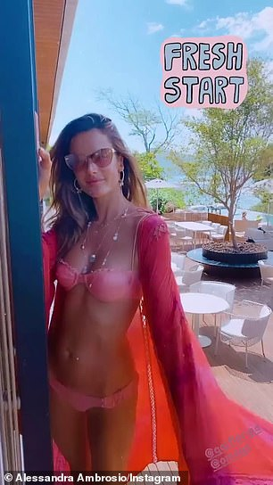 Casual: She posed for a video on the deck of her hotel room, while swinging the sleeve of her swimsuit coverup threw the air
