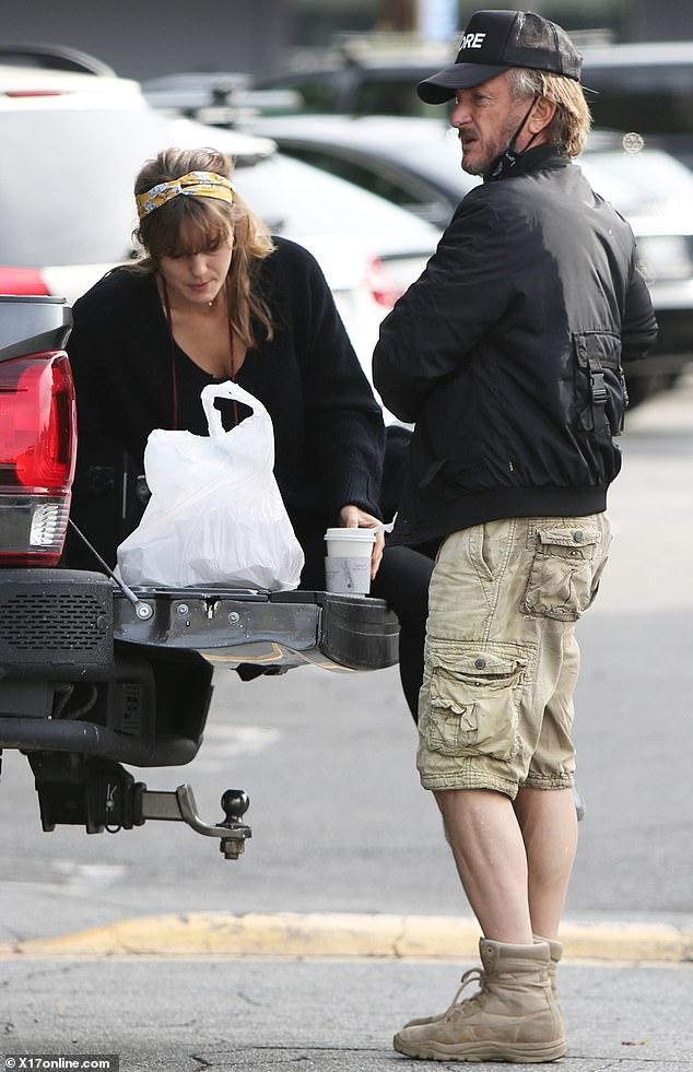 Sean Penn keeps it casual in black bomber as he has parking lot picnic with wifeLeila George in LA