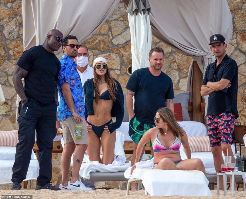 Squad: The budding couple were seen with a few friends as they all relaxed on the beach