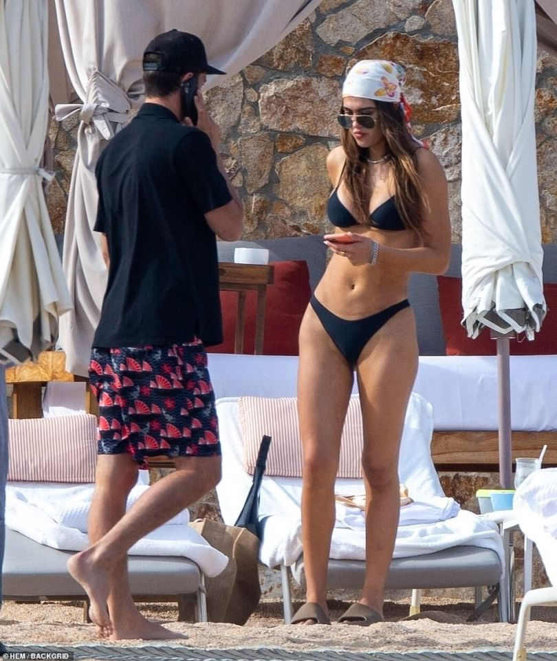 Ring ring: She and pal were seen chatting by their beachfront lounges