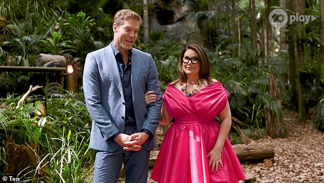 The secret's out! Meanwhile, I'm a Celebrity viewers have guessed the identity of the show's next intruder. Pictured hosts Dr Chris Brown and Julia Morris