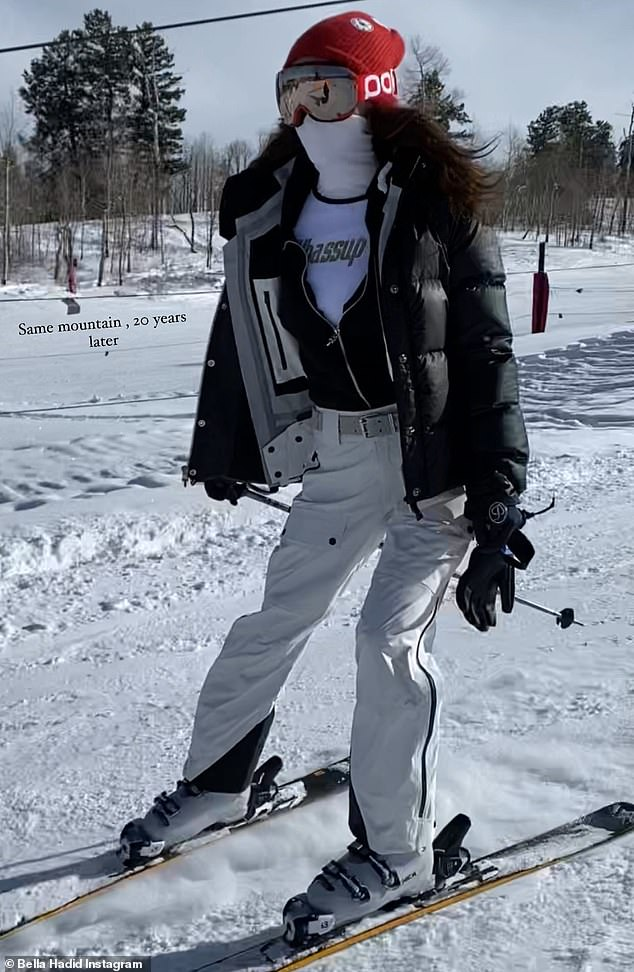 Ski chic: She went incognito in her ski look, rocking several layers of black and white with a red beanie, reflective red goggles and a white face mask