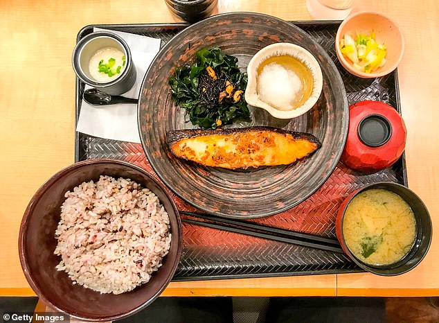 Elaborate traditional breakfasts are very common in Japan (stock image of a typical Japanese meal with pan-fried fish, steamed pork with rice, miso soup and pickled vegetables)