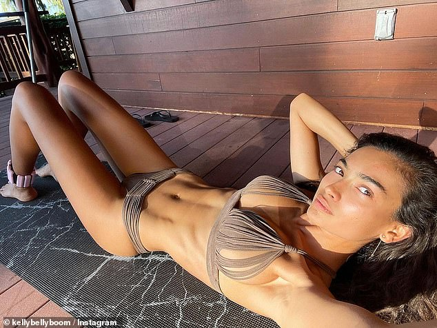 Sizzling: On Monday, Kelly Gale showed off her jaw-dropping figure in all its glory, as shestripped down to nothing but a skimpy bikini to celebrate her 'first workout' of 2021.