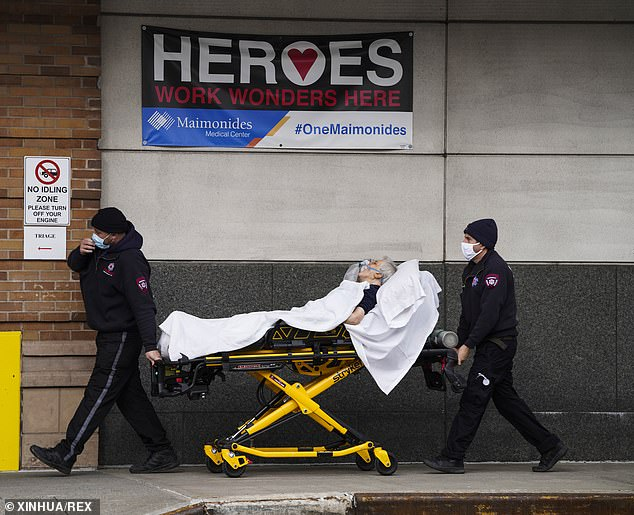 A COVID-19 patient is wheeled into a New York City hospital on New Year's Day