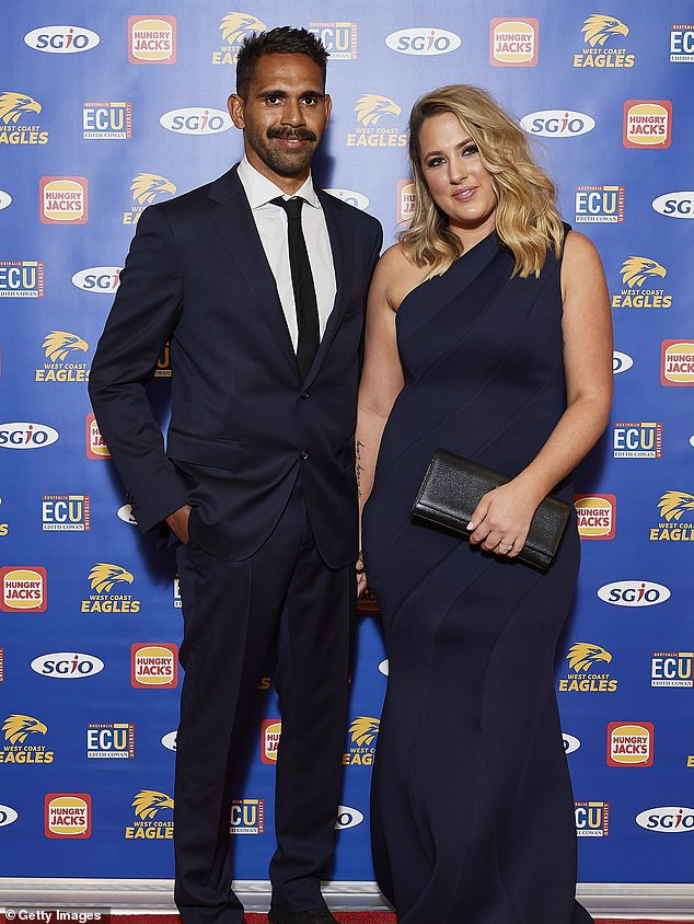 Aboriginal AFL star Lewis Jetta was repeatedly 'racially abused and taunted' at a New Year's Eve function in Perth (Pictured: Jetta with partner Jess Miller)