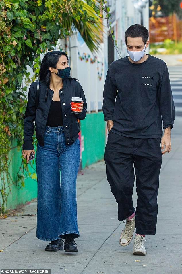 Dating: The actress, 26, later met up with her boyfriend Grayson Vaughan in LA's Silverlake neighborhood and she clutched a cup of coffee to go as they chatted