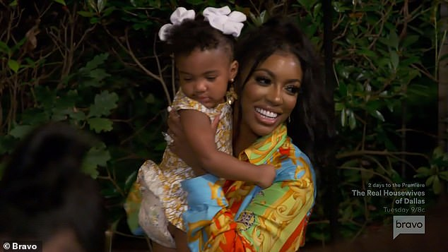 Civil rights: The 39-year-old reality star held her daughter Pilar Jhena as she gave a heartfelt speech to her friends about her activism