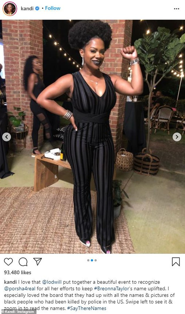 Black Lives Matter: The 44-year-old donned a '70s chic sleeveless jumpsuit, as she raised a Black Power fist for a photo op at the intimate gathering