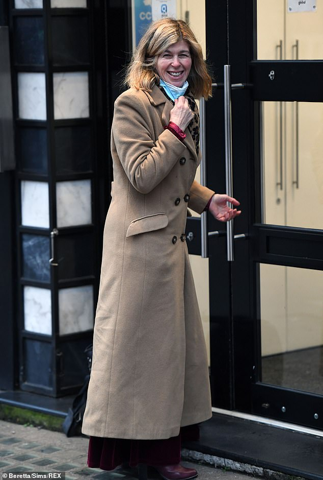 Strong: Kate Garraway continued to smile as she returned to her Smooth FM radio show following a 'calamitous' Christmas without husband Derek during which her house flooded