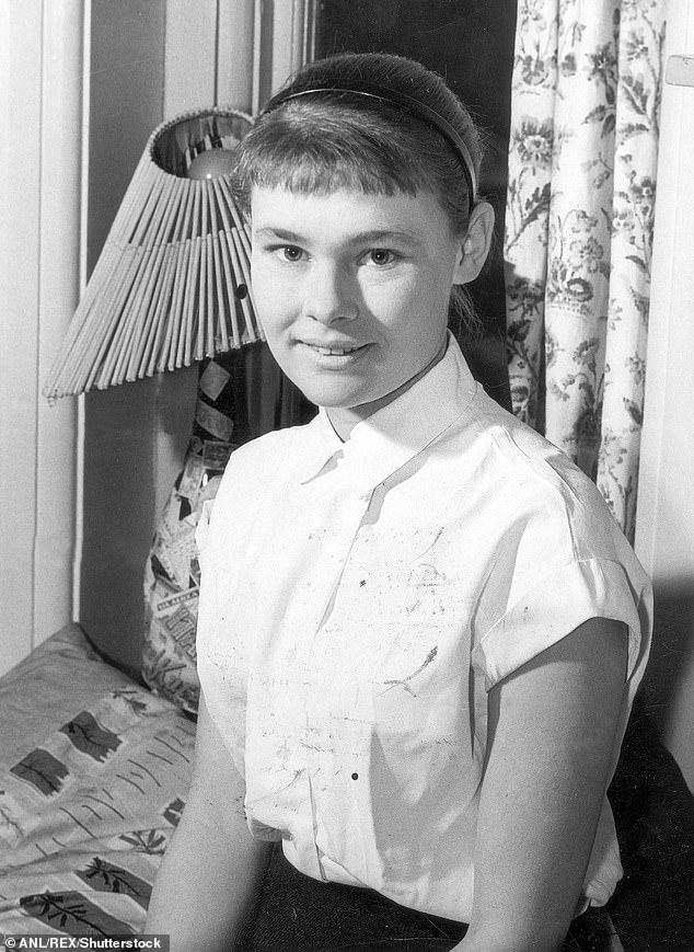 Judith Dench:The actress, 86, explained her parents Eleanora and Reginald hadn't chosen a moniker for her immediately after she was born - but a chance meeting with a woman who claimed to communicate with spirits led to them calling her Judith (pictured 1957)