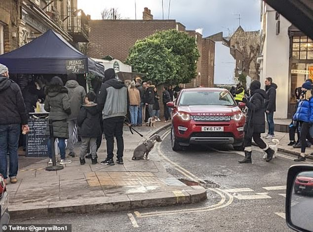 Motorist Gary Wilton tweeted two pictures, including this one, of queues wrapped around the pub which meant pedestrians walking in the area had to move into the road to get past
