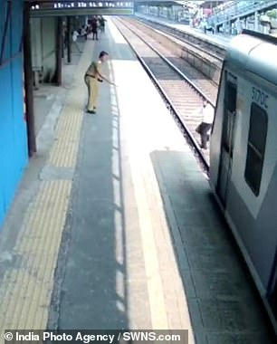 CCTV footage shows Gopal Solanki as he crosses the tracks at the Dahisar railway station in Mumbai, Western India