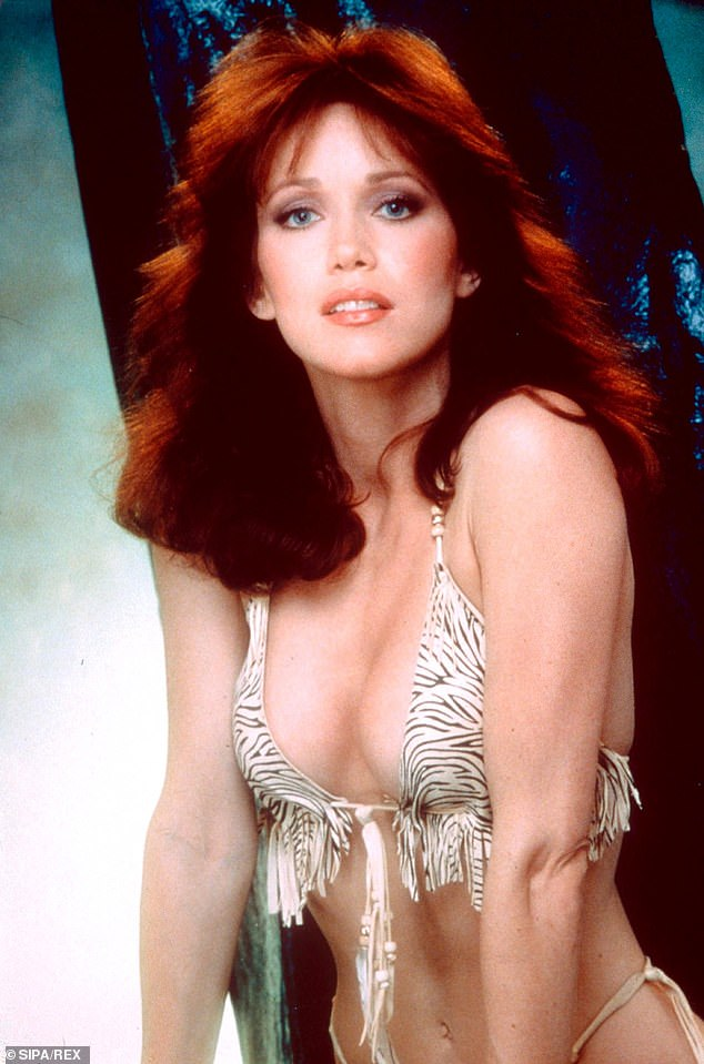 She sold her redheaded bombshell image: In a glamorous portrait shared in 1983