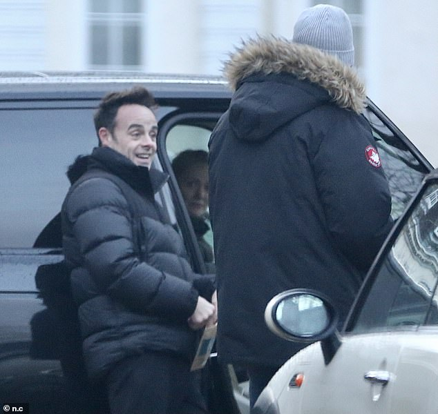 Delighted:Newly-engaged Ant McPartlin looked delighted on Monday during a relaxing stroll with his fiancé Anne-Marie Corbett following his romantic Christmas Eve proposal