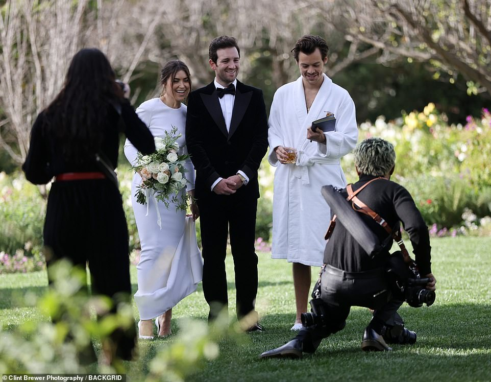 Did he officiate?He was seen clutching onto a book - which may have indicated that he conducted the ceremony for his close friends