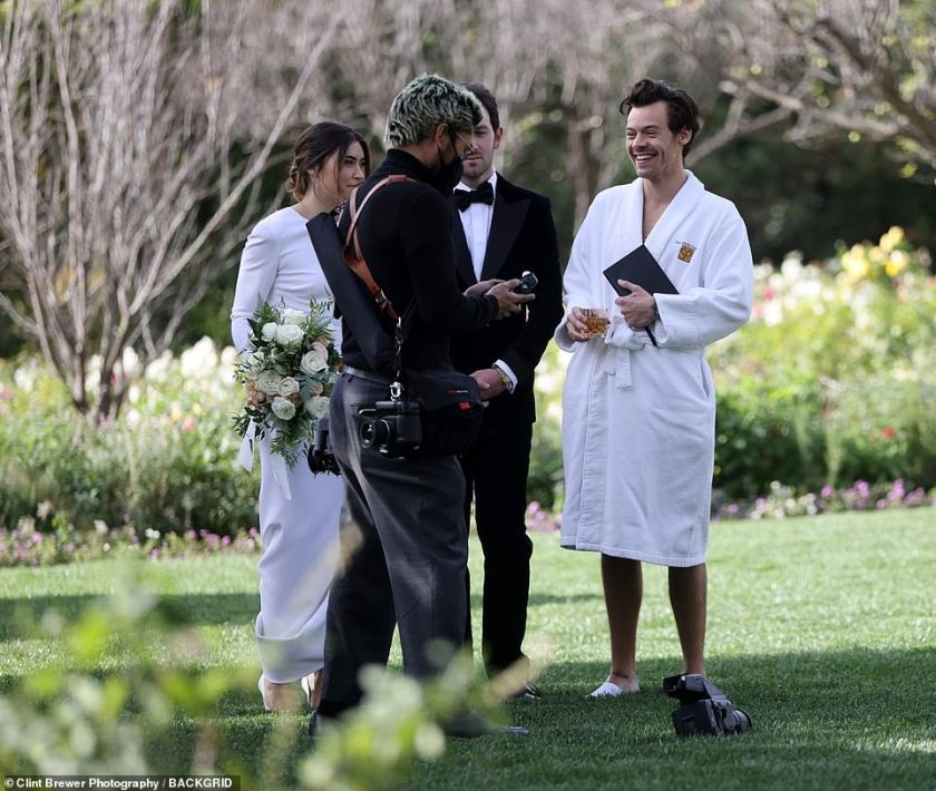 Fun: Harry cracked a few jokes with the wedding photographer as the group prepared to shoot