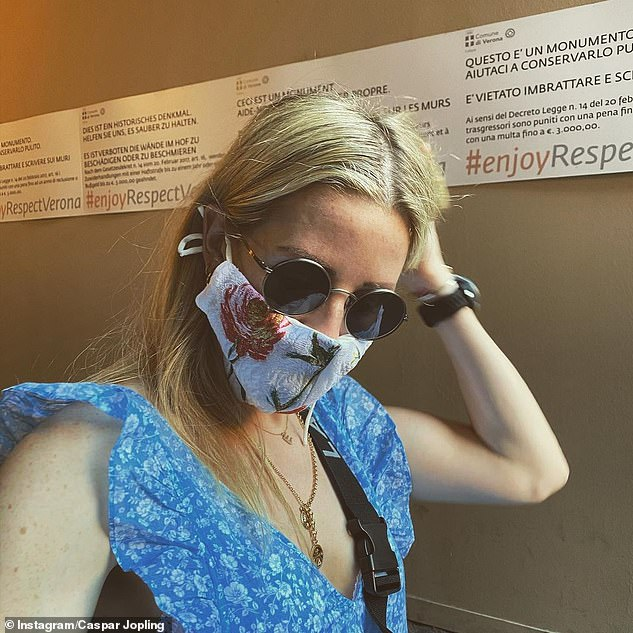 Candid: Caspar posted a snap of Ellie wearing a floral facemask