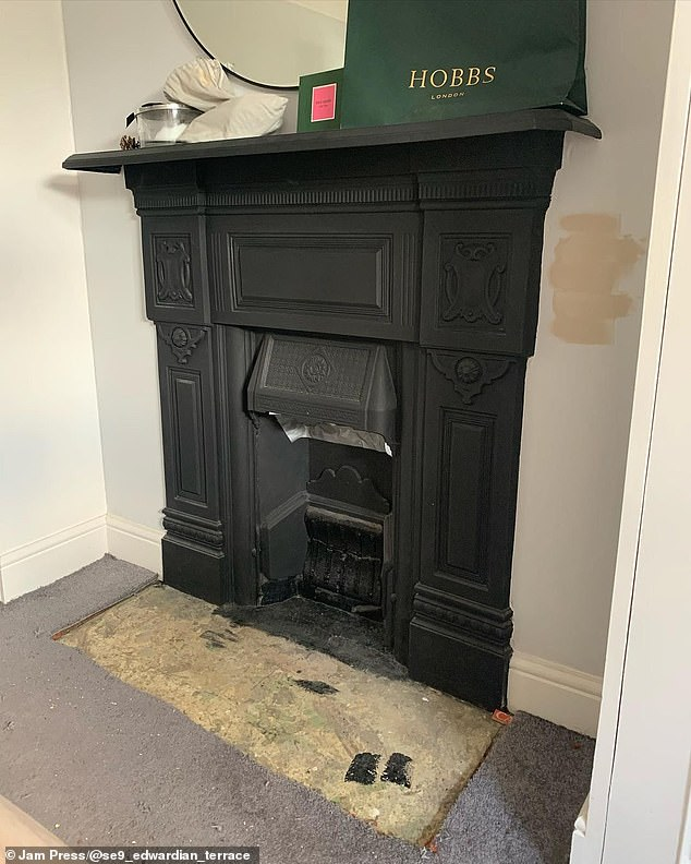 The couplehired a builder to skim the walls and build shelving on either side of the chimney breast, which they then primed and painted
