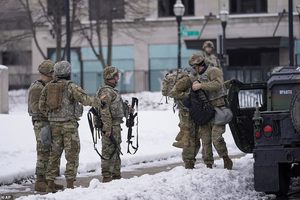 Wisconsin had already started to brace for renewed protests ahead of the DA's decision with Gov. Tony Evers mobilizing 500 National Guard troops to help Kenosha authorities. National Guard members pictured Tuesday outside a museum on Kenosha