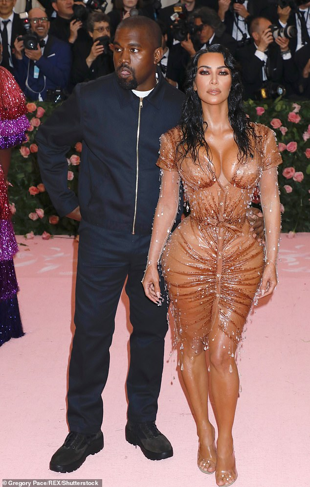 Holding on: Last month it was claimed that Kim and Kanye were still together but 'living separate lives'