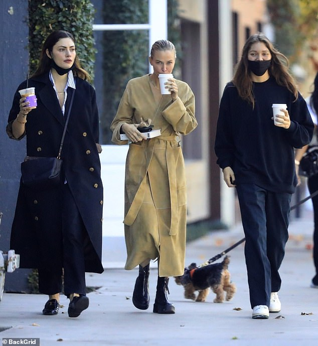 Girls's day out! Lara Worthington (centre) enjoyed a coffee break with actress Phoebe Tonkin (left) in Beverly Hills on Monday. They were joined by formeradult actress Jessie Andrews (right)