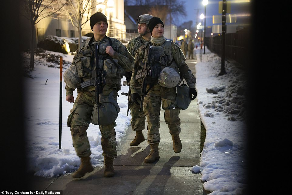 National Guard troops gather around theKenosha County courthouse Tuesday in a pre-emptive measure to deter any violent reaction to the DA's decision