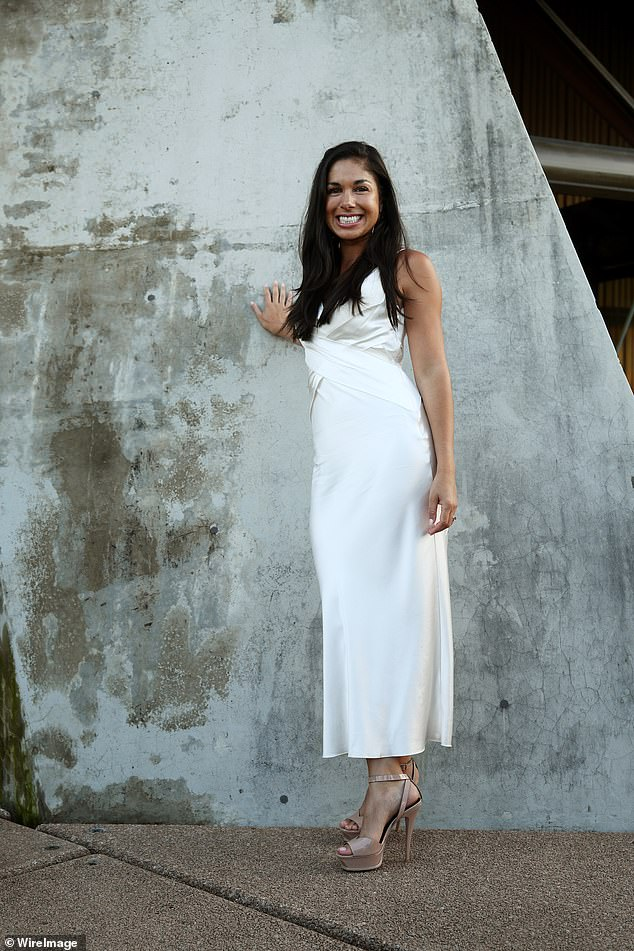 Elegant: The dress featured spaghetti straps and cross detailing across the bodice, and finished just above the ankles