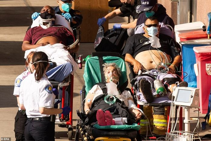 Arizona, California and Rhode Island are seeing higher rates of COVID-19 infections per capita than any country in the world as the US grapples with skyrocketing cases, hospitalizations and deaths. Pictured: Patients wait on gurneys outside the overcrowded LAC USC Hospital emergency room in Los Angeles on Tuesday