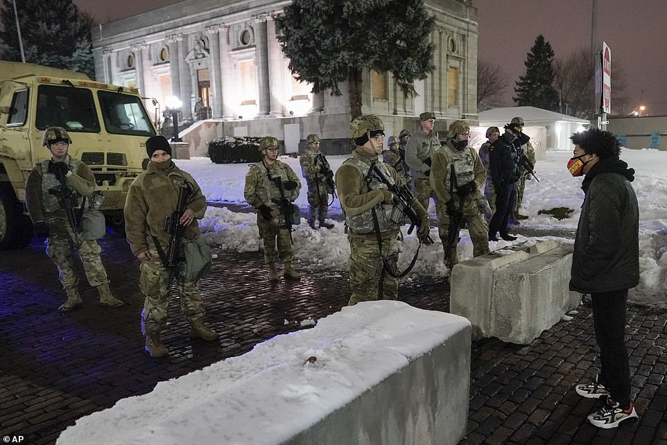 Around 100 members of the National Guard surrounded the local courthouse and other government buildings in the town square after the announcement