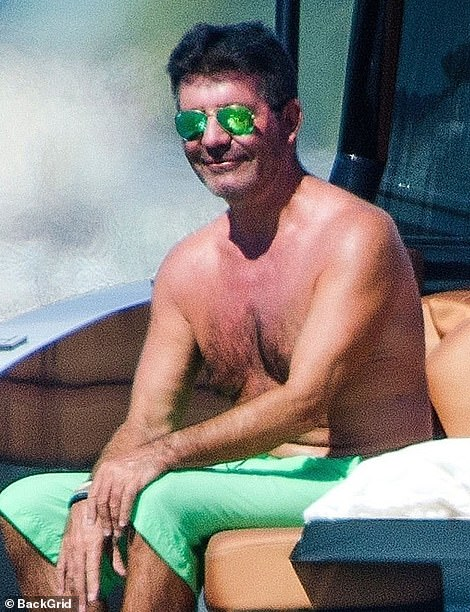 Low-key: The mogul went shirtless for the boat day as he continued to recover from breaking his back in August