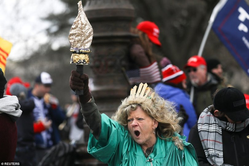 Leigh Ann Luck dressed up as Statue of Liberty shouts as supporters of U.S. President Donald Trump protest