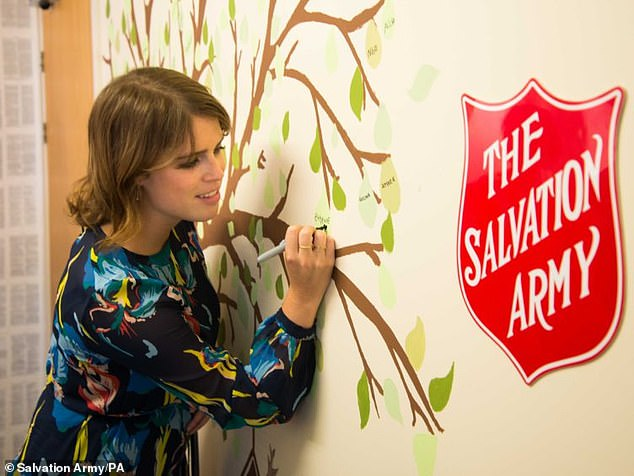 Princess Eugenie gave Salvation Army safe house residents Christmas gifts of crafts and other activities to 'help with their well-being' as they stayed safe and continued to recover from their experiences of modern slavery. Pictured, during a previous visit to the charity