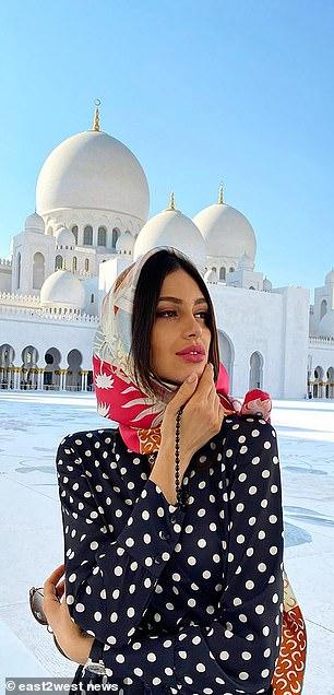 Oksana Voevodina outside a mosque