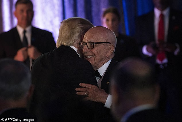 Rupert Murdoch is pictured embracing Trump in May 2017 but has since turned on him