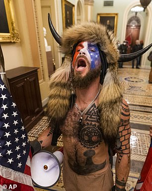 Carlson accused the Republican party of not supporting Trump's base. Pictured, a supporter of President Donald Trump chants outside the Senate Gallery inside the Capitol