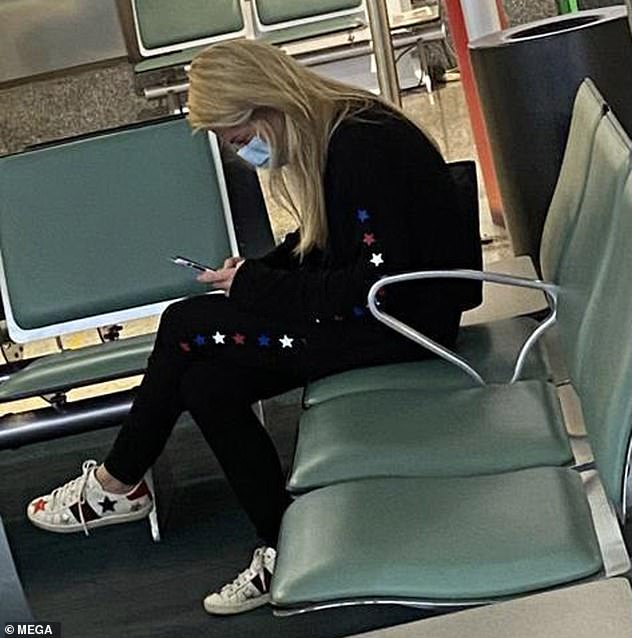 He was released from the medical facility just hours after his girlfriend Miss Holland, 25, jetted back to Britain. She was pictured atGrantley Adams International Airport on Wednesday night
