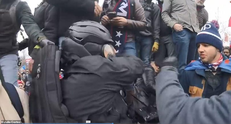 Multiple times, Minchillo is grabbed and shoved through the crowd as angry rioters yell at the photojournalist