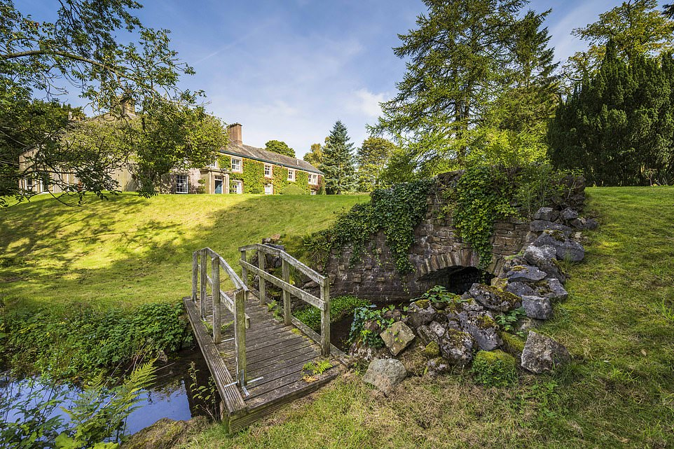 'There¿s a definite serenity to this ivy-clad mansion,' writes Sarah, 'with small streams and glades in the grounds and sheep-dotted landscapes and dense woodlands beyond'