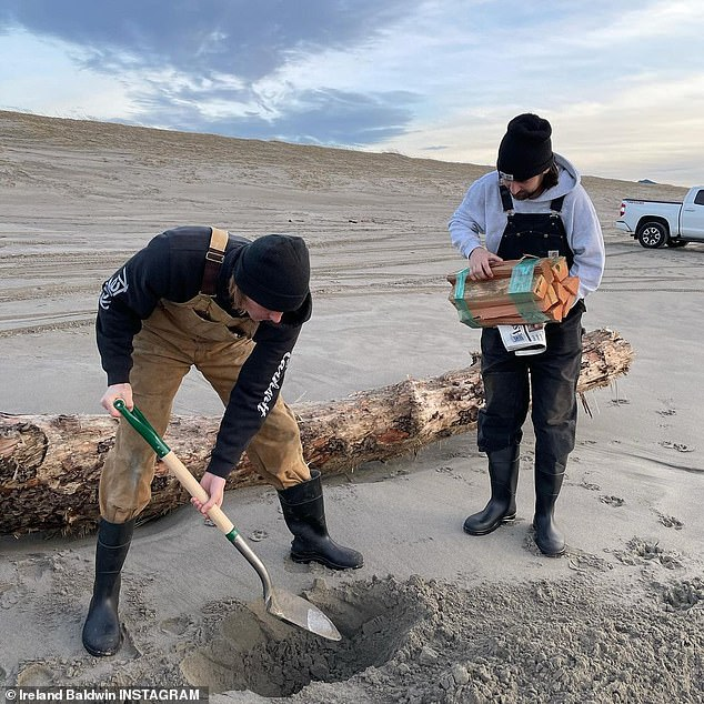 Out with friends: Ireland was joined by her boyfriend, musician Corey Harper, and another friend who held a bundle of firewood