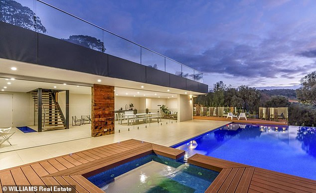 What a way to relax! The Mitcham property also has a pavilion area with a deck area and a spa, perfect for entertaining guests and enjoying the spectacular view out over the city and out to the sea