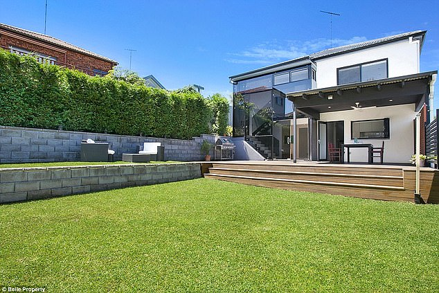 Sydney pad: As their dream home continues to be built, the couple and their daughters are living nearby in a $2.3million four bedroom home with a spacious backyard (pictured)