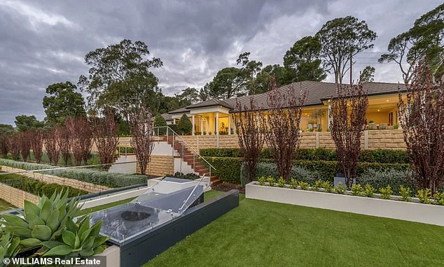 Picturesque: The house (pictured), nestled in the Adelaide foothills, features four bedrooms, as well as another room which has the potential to be a fifth bedroom or an office/study room