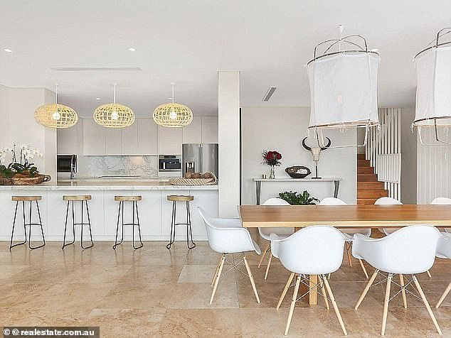 Elegant: The three-level home had five bedrooms, four bathrooms and boasts sweeping ocean views, as well as bright and beach style interiors