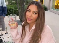 Kim Kardashian toasts to '20 seasons of craziness' as she and the crew of KUWTK wrap final shoot