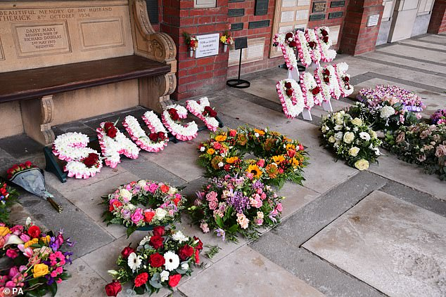 "Floral tributes: Flowers spelling out Babs, The Dame and Saucy adorned her coffin, while a topless photo from her Carry On days was included in the order of service, accompanied by her quote: ""That picture will follow me to the end"""