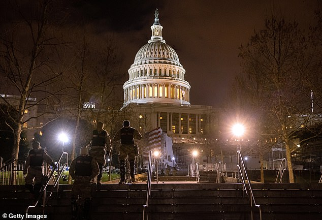U.S. National Guard troops walk through the grounds of the U.S. Capitol on January 06