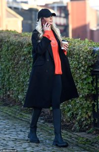 Olivia Attwood cuts a casual figure as she sips coffee on an afternoon walk